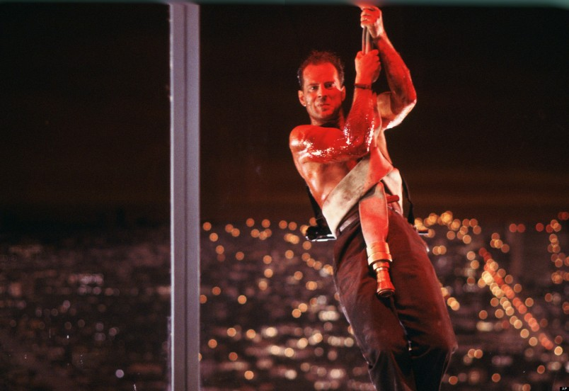 """This publicity photo released by Twentieth Century Fox Home Entertainment shows Bruce Willis in a scene from the 1988 film, """"Die Hard."""" The """"Die Hard"""" 25th Anniversary Collection Blu-ray released on Jan. 25, 2013. (AP Photo/Twentieth Century Fox Home Entertainment)"""