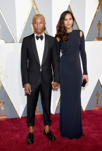 Pharrell Williams (L) and Helen Lasichanh
